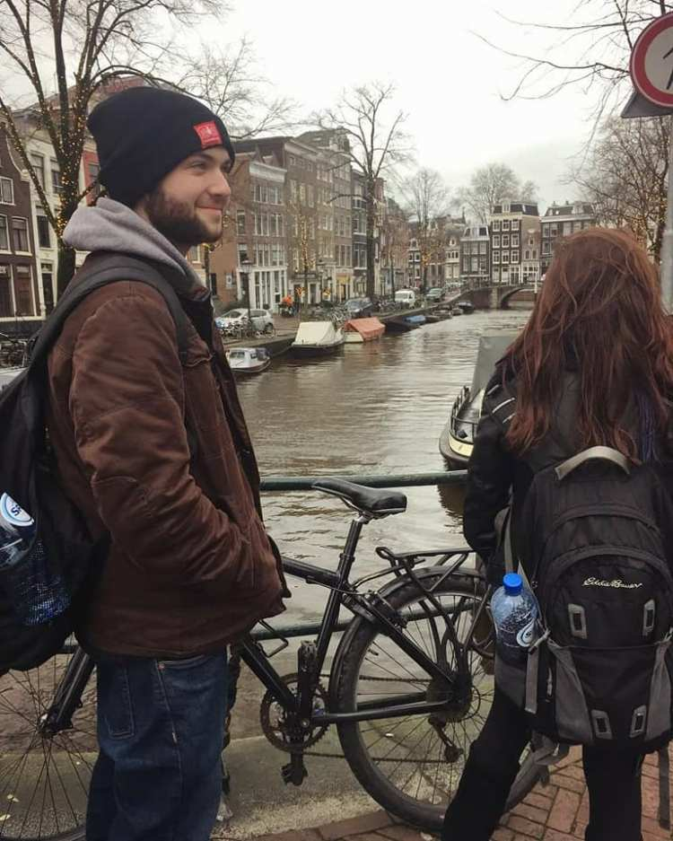 Christmas time in Amsterdam on a canal with bikes