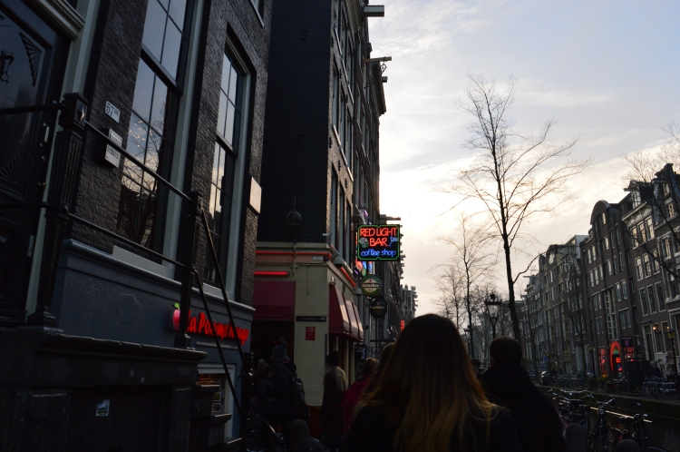 walking through the red light district in amsterdam
