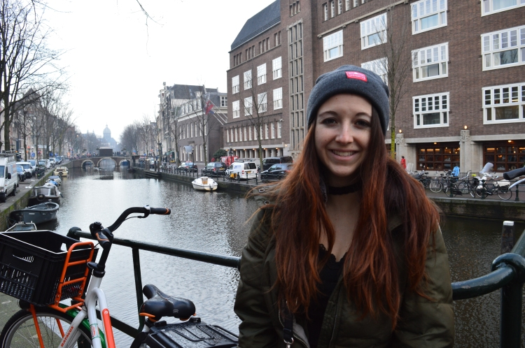 Amsterdam canals tourist smiling