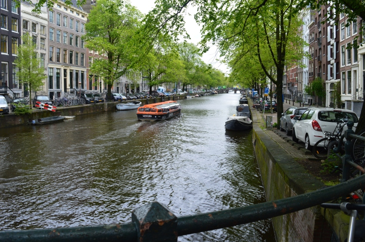 tourist sightseeing boat in canals in Amsterdam