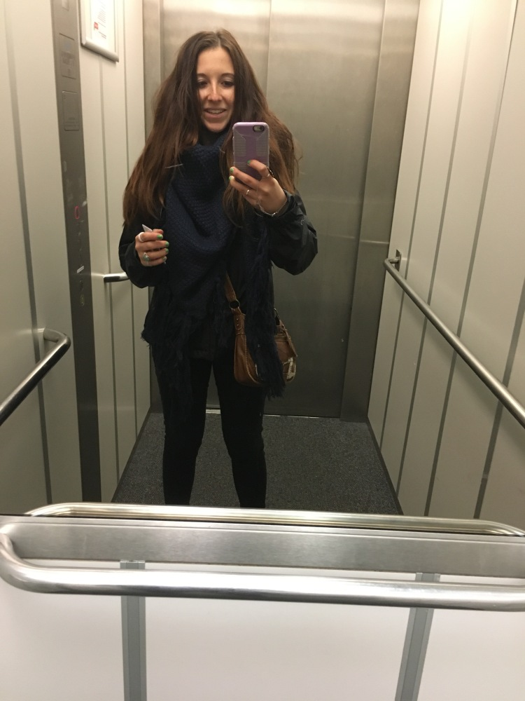girl takes selfie in an elevator in hostel while traveling