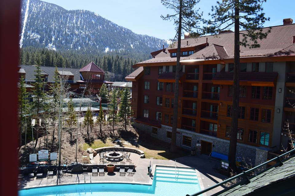 Lake Tahoe pool at heavenly ski resort with wood lodge and snowy mountains