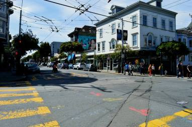 intersection and tram lines over a quaint neighborhood in San Francisco