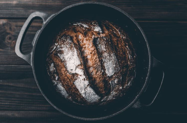 cast iron pan with sourdough bread