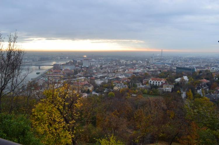 An aerial view from Budapest, Hungary during the fall season with colourful leaves on the Danube