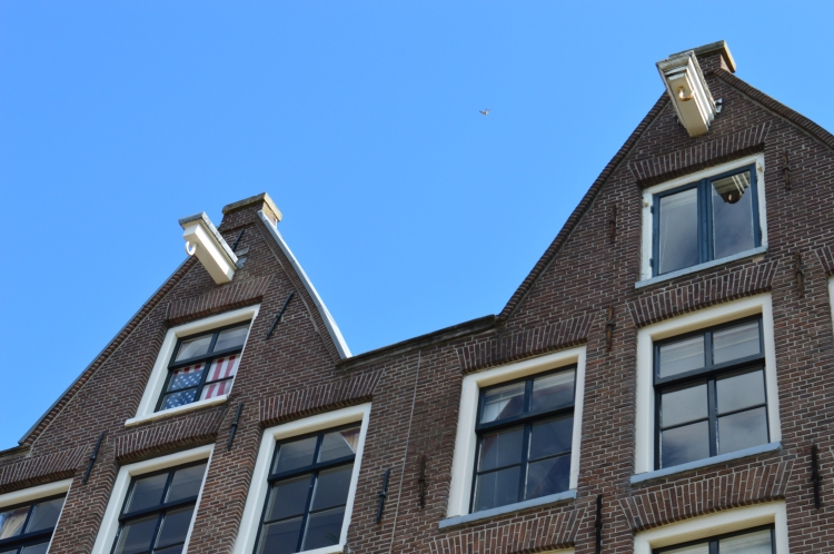close-up of an American flag in a window of a dutch row house on a canal in Amsterdam