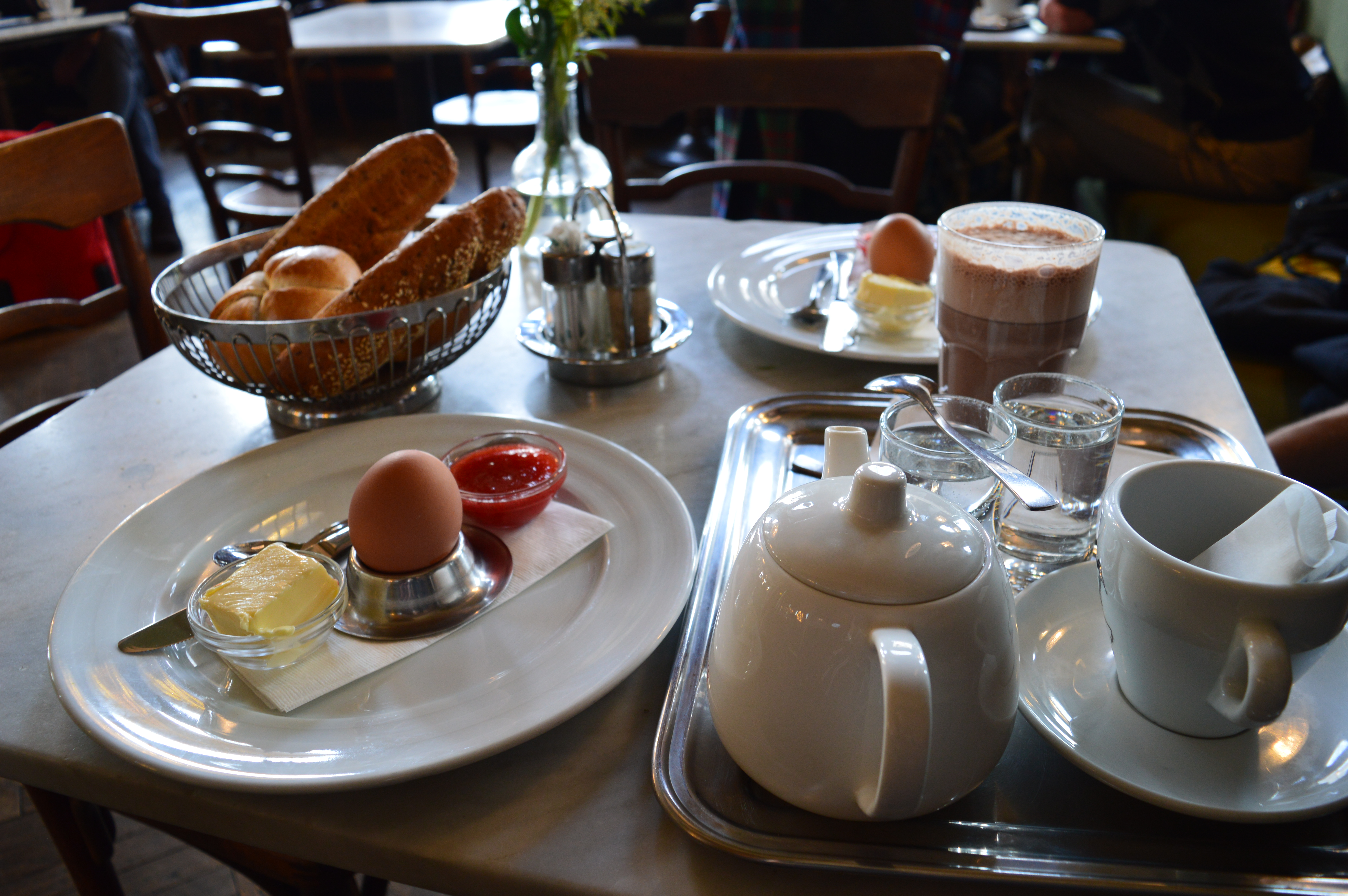 viennese breakfast with hard-boiled eggs, bread, butter, jam and coffee in Austria