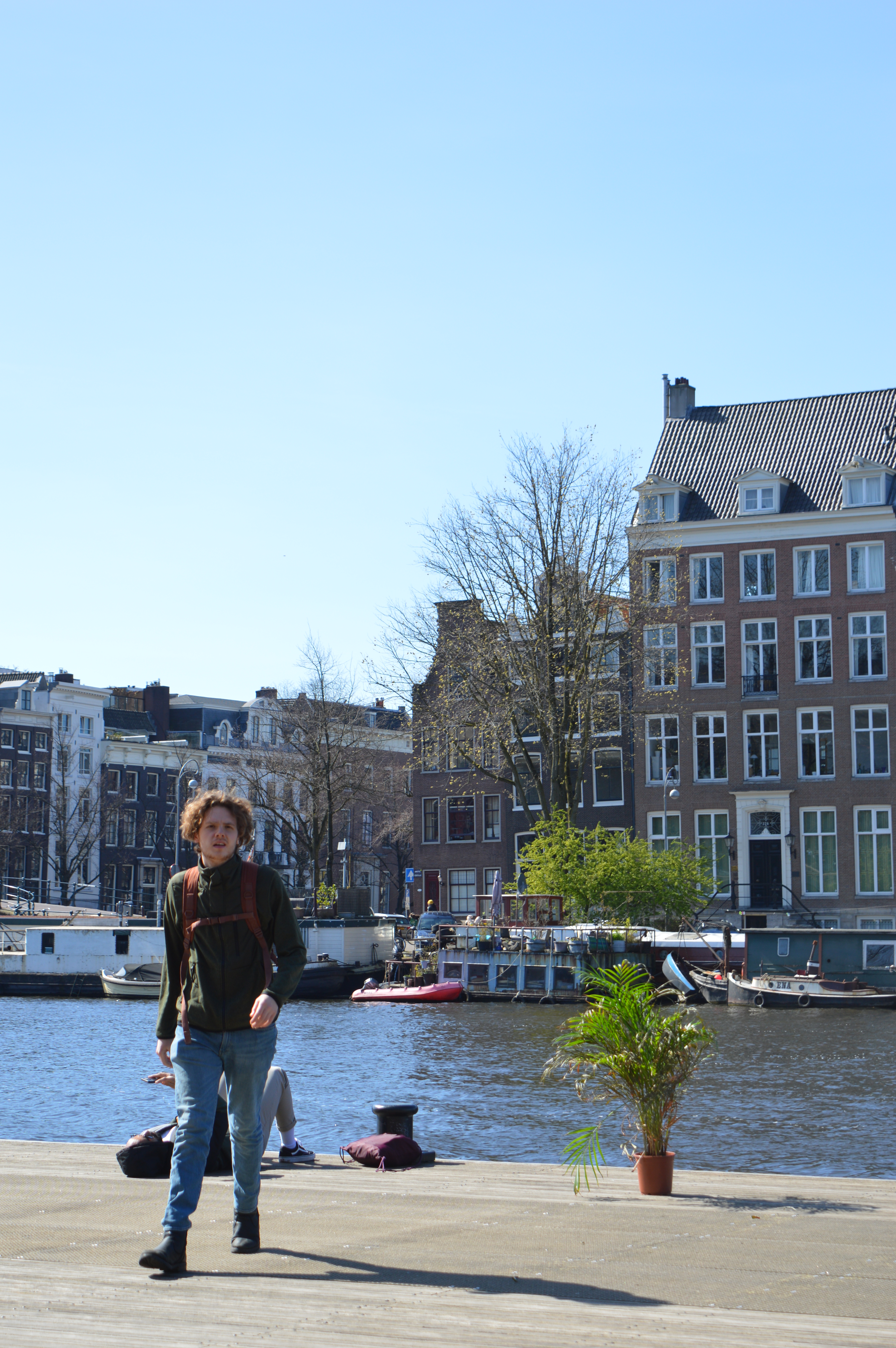 man walking away from the water in Amsterdam