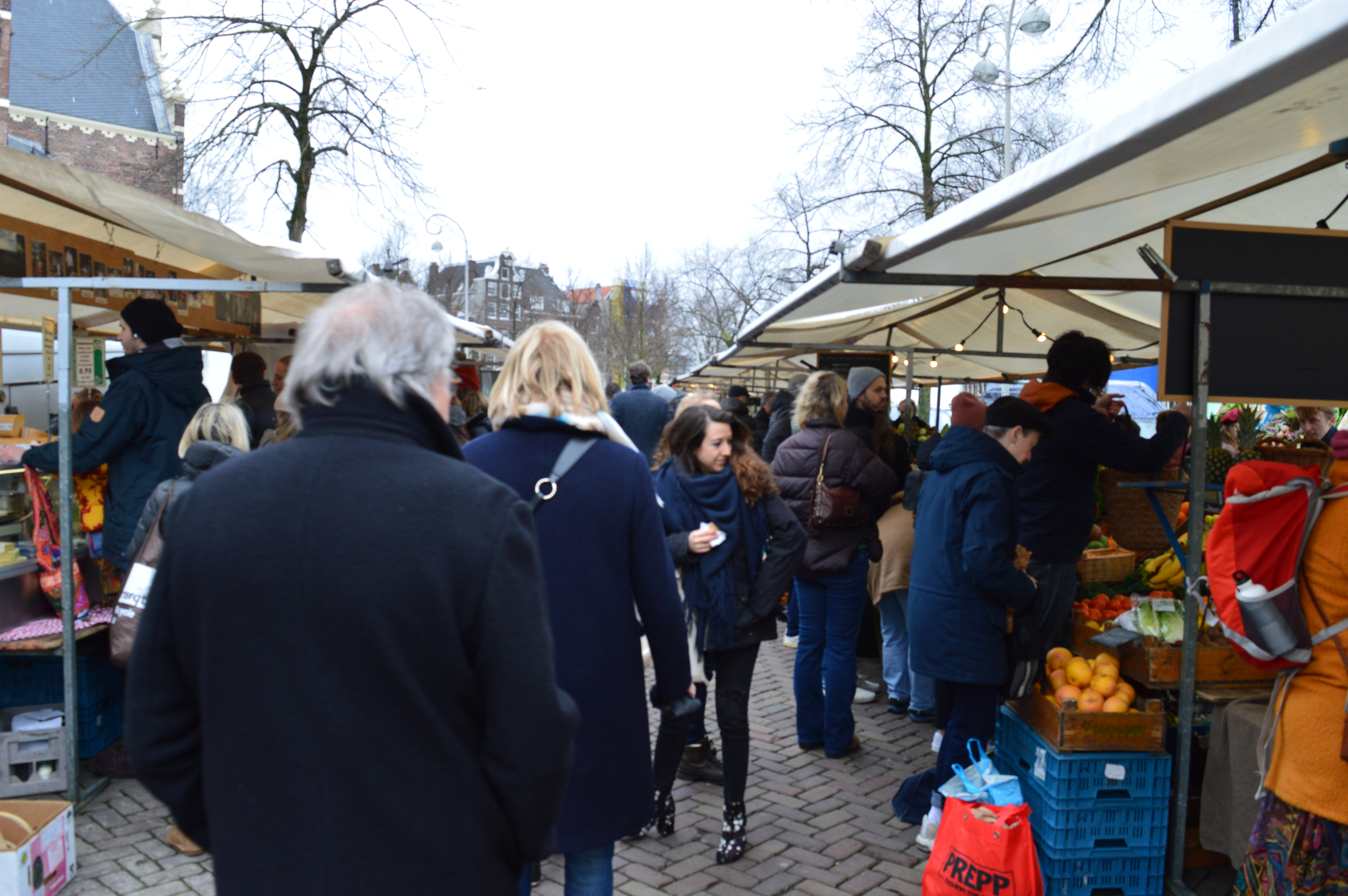busy weekend market filled with people in Jordaan in amsterdam